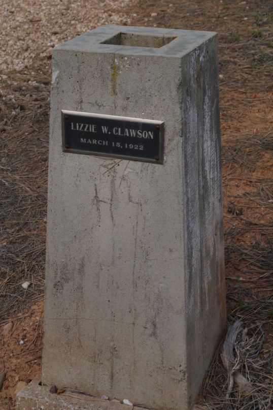 Lizzie W. Clausen, his wife, died in 1922. The concrete pillar is still holding nicely.