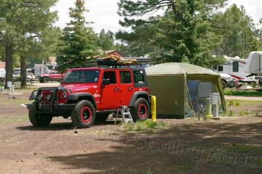 Back in camp, one guy got his sleeping/lounging/office area just the way he wanted it. The tent was amazingly full, and how he jams it into the Jeep is a mystery to me.