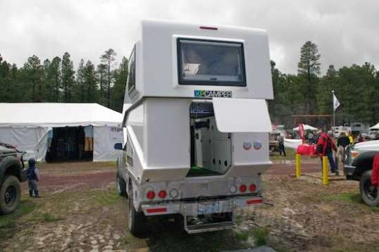 One model of XP Camper uses a hinged clamshell to allow a pop-up's air drag and CG advantages with the protection and insulation of a hardwall truck camper.