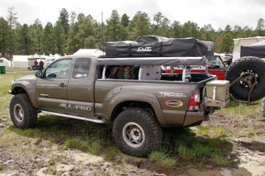 An interesting setup, a rooftop tent with what looks like ARB's version of an awning with a cover on it.