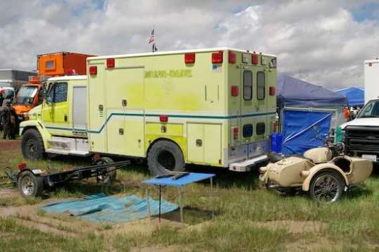 A retired ambulance that's seen better days. 2WD. But looka that storage!