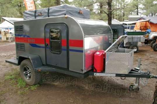 A GOBI exterior, with storage/propane box and fuel, water, or whatever you want jerry cans.