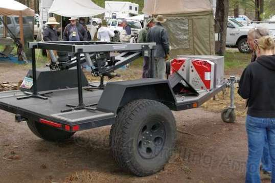 A trailer for hauling whatever you can strap down to it. In this case it shows off a Timbren suspension setup made specifically for rough off-road clearance. Leaf springs will drag and bend the axle, and torsion suspensions have the reputation for spontaneously disassembling in the rough stuff. This is adjustable and battle-tested.