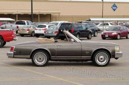 At a Sam's Club in Nebraska, I looked out the camper window to see an old Cadillac Seville convertible with wonky proportions.