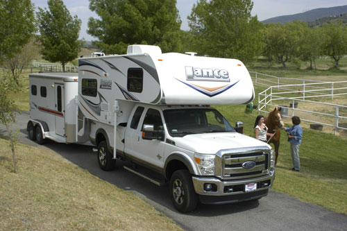 i see quite a few of this type of rig out West: truck camper and horse trailer. Campin' & ridin'.