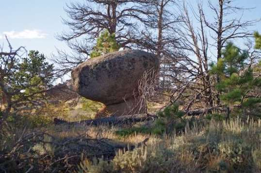 One rock balanced on top of another.