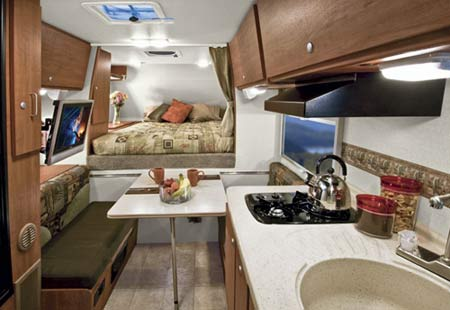 "Interior of the Lance 830, which will never look this neat and ""House Beautiful"" once it's sold."