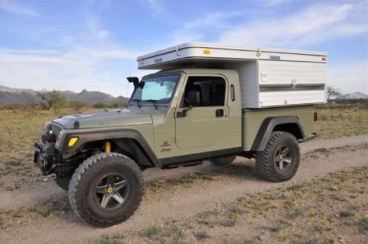 "Equally serious for the outback is an AEV Jeep Brute ""pickup"" with a stubby Four Wheel pop-up in its newfound bed."