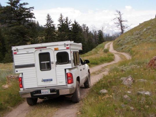 Nearly ANY truck camper can take this trail. The issue here is your confidence level toward whatever it does on the other side of that hill. On a trail, what's past is not a reliable indicator of what's ahead.