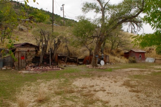 "Here's a ""vacant"" property along a main drag that has a power box and water supply for an RV at center, and a shack-covered mineshaft at each end! Rockhounds Gone Wild!"