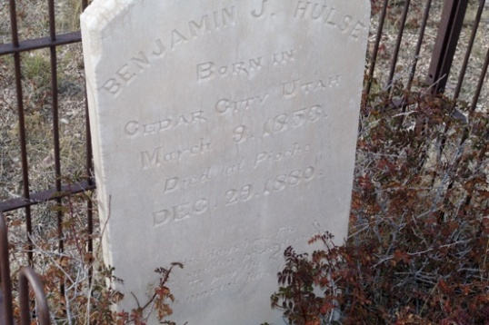 "This fatalistic gravestone is for Benjamin F. Hulse, born in 1853 in Cedar City, Utah. He died here in 1880. The inscription reads, ""His days how few, How sudden passed away, To pay the debt, Each mortal has to pay""."