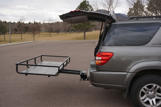 The Let's Go Aero GearCage platform slides out to allow close access to vehicle contents.