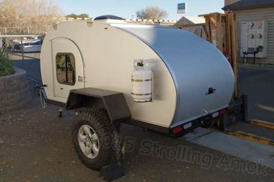 I found this interesting - a teardrop for towing behind your Expedition Vehicle. With a kitchen galley hidden under the rear cover, it allows an alternative to tent camping wherever you like. Adventure Trailer provides the frame and running gear only, the body made by someone else for the ultimate seller somewhere else in the state.