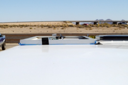 Here's a view from the driver's side rear, showing that the panel must not be allowed to shroud the solar panel roof connector, which is the bump toward the right side. This panel really needs to move toward the roof vent, and forward to get away from it.