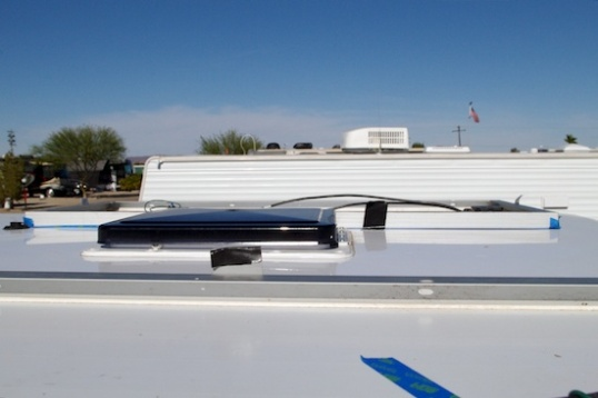and this shot from the passenger side shows that the panel can't afford to be moved forward very much. Taper near the roof edges and aerodynamic pressure at speed will test the mettle of any panel mounted with adhesive. These are monocrystalline panels, which are the only type narrow enough to fit in this position.