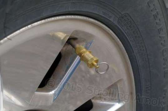 This is a Coyote automatic tire deflator, which does the same thing a puncture does, but without a repair being needed.