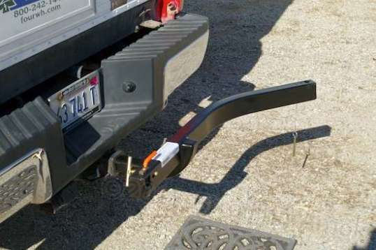 The frame slips into the hitch receiver, and you can retain it with the supplied pin, or with your own locking hitch pin.