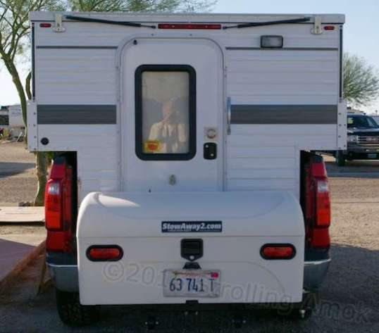This cargo box is mounted to the rear hitch receiver. How am I going to get in and out of the camper? Good question!