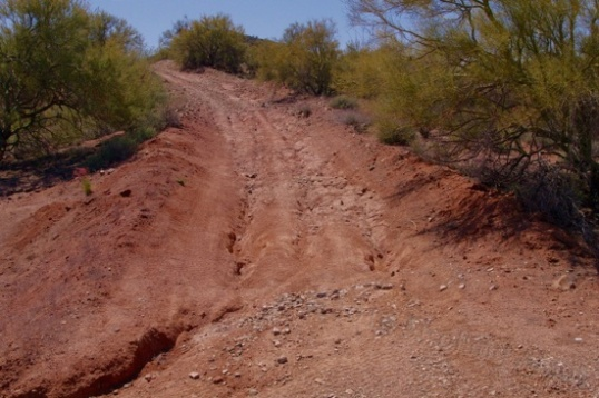 Start right, cross over to the left and stay there. Up ahead is a stretch of solid rock, then tons of loose rocks.