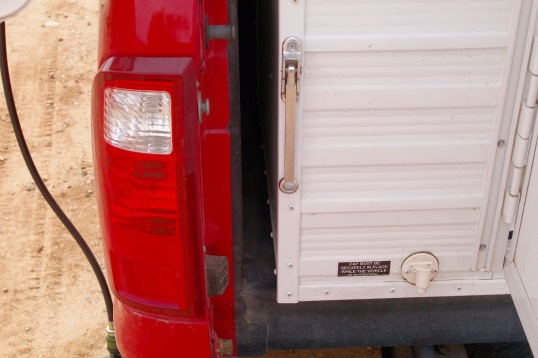 Not much to see here: the side-gap between the camper and the truck bed wall.