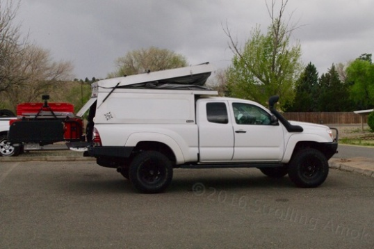 Fitted onto a Toyota Tacoma, the truck bed shell opens...