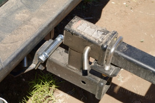 On this Curt adapter, the StowAway hitch tightener is above on the right, while the Quiet Hitch tightener is below left.