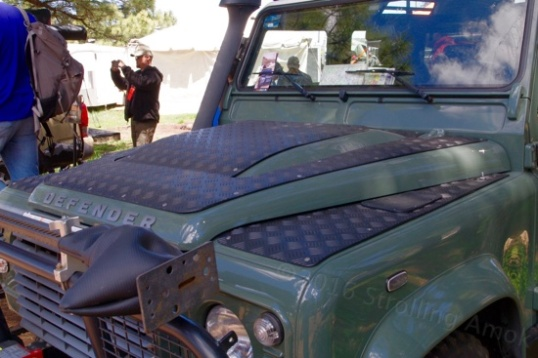 This old Land Rover Defender has rubber sheets bolted to its hood and fender tops. I don't know what they're supposed to be protecting the paint from.