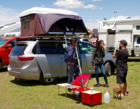 Minivan livin'. They seemed to have a sort of modular table, stove, and cookware box.