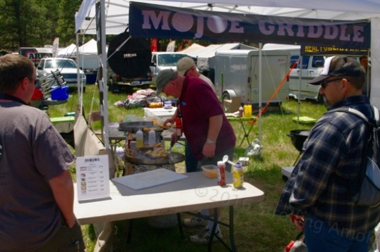 The MoJoe Griddle display is always popular, especially when demonstration time comes around. They can be placed over a Weber grill, or for campers, suspended or legged over a campfire or turkey fryer base.