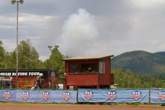 "That plume of smoke over the announcer's stand is controlled burning in the area that has gone on for several days, initiated by lightning strikes that were ultimately put to constructive use. Always makes me a little uneasy though. ""Where's the smoke, and where's my camper?"""