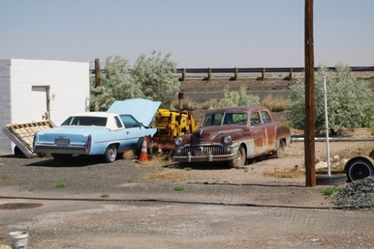 Some kinda Chrysler product next to the Caddy, I think. There are plenty of such relics scattered throughout Arizona.