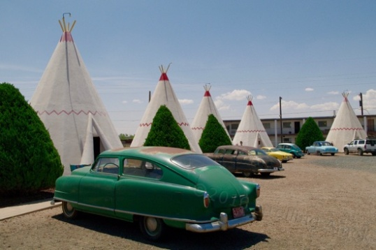 "Even though these old cars are here for effect, there's still plenty of parking room. i noted that the teepees are in fact smooth-finished concrete painted over, and that one ""flap"" houses a window air conditioner. Now I suspect that these might not be real teepees."