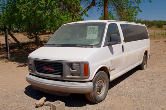 """Wow, a 1997 1-ton Chevy passenger van parked out in front of a church, and they want just $1,000 for it! I noticed that it's been here a good long time, maybe because the sign says """"bad motor""""."""