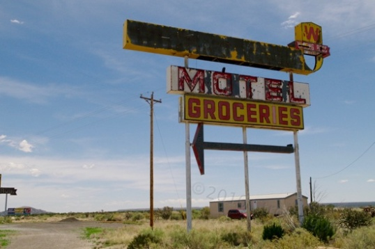 The arrow points to a motel and grocery store just on the opposite side of 66. These days, it's just a bare concrete foundation close to the road.