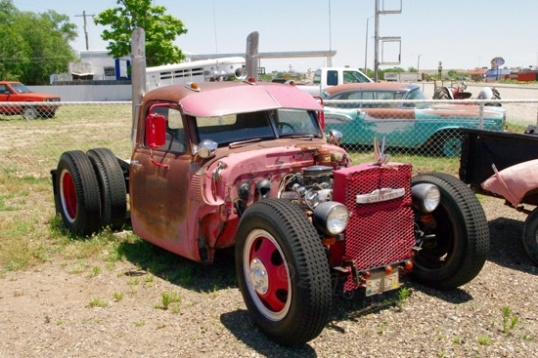 The one on the left caught my attention, since it's a medium truck frame with a pickup cab dropped onto it. This is not your typical big-buck Model A resto-rod.