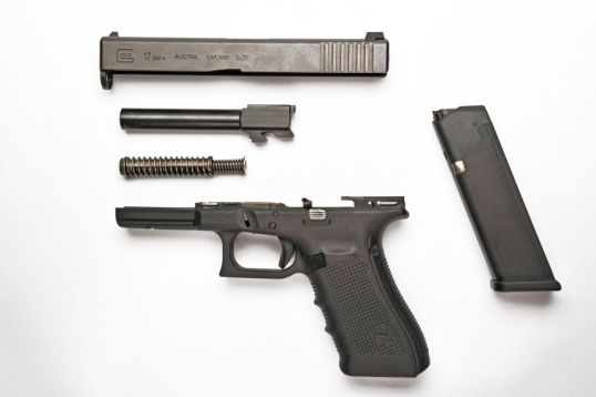 Field stripping a Glock for cleaning is simple and is done without any tools.