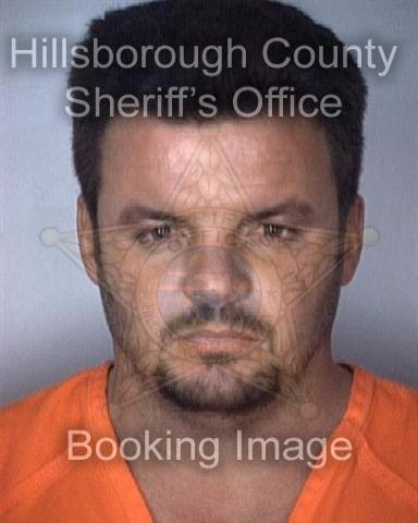 "Mr. Broche's mugshot from 1997, when he was booked for ""soliciting another to commit prostitution""."