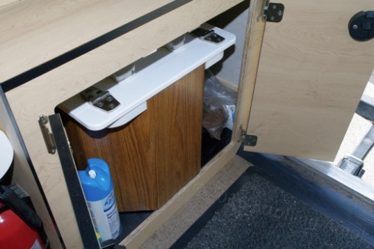 The C-Head BoonJon inside the Grandby's ear passenger-side cabinet.