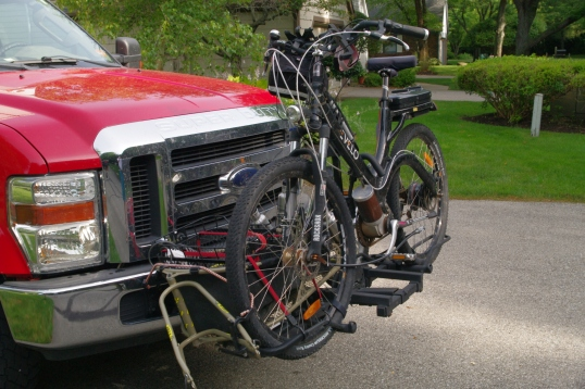 The Evelo Aurora cannot be carried by a top-tube carrier, so a wheel hoop carrier is called for.