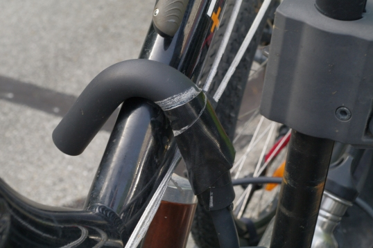 Since the foam around the hook has worn, I did a token fix by wrapping Gorilla tape around the worn spot. Paint is worn off the bike's tube as well, since the tube is so low. This magnifies the bike's leverage on the hook.