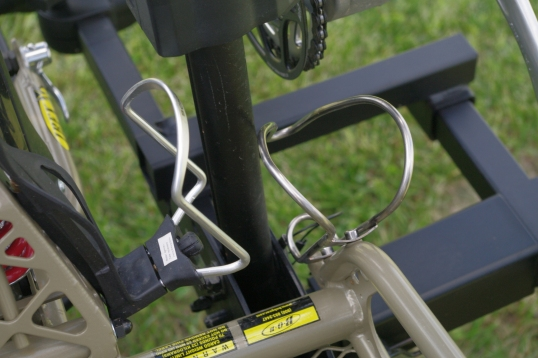 The rearward hoop pair also required fine side-to-side adjustment so that my trailer's bottle holders would clear the vertical tube, and still provide a hoop in the right place to drop the trailer's wheel into.