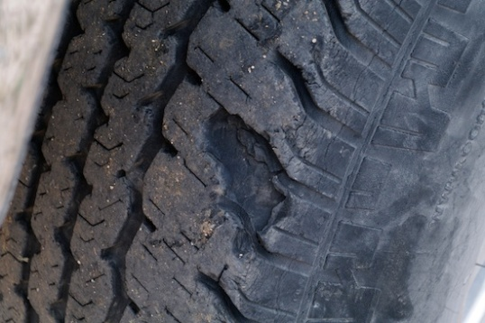 These are 7-year-old Continental Contitracks after running on some gravel. Forget squeezing the last few miles out of tires like this. Gravel can make short work out of older street tires.