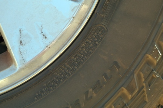 You can't read this photo, but tires have an area on the sidewall for maximum loading and maximum cold tire pressure. Light truck tires also have a service description that will refer to charts with the maximum speed that the tire can be run under maximum air pressure and load.